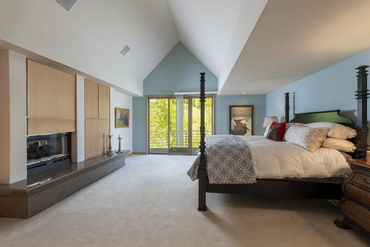 Bedroom with fireplace inside Vail's 4249 Nugget Lane