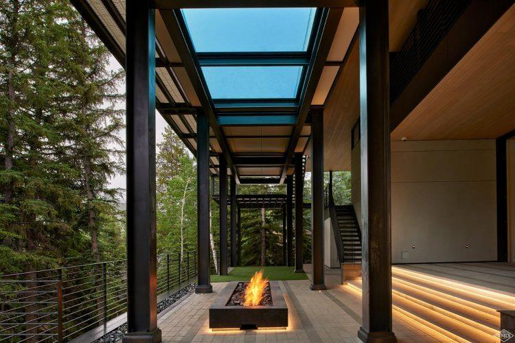 165 Forest Road on Vail Mountain: walkway with fireplace