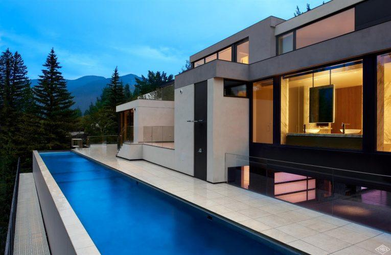 165 Forest Road on Vail Mountain: exterior at sunset with pool
