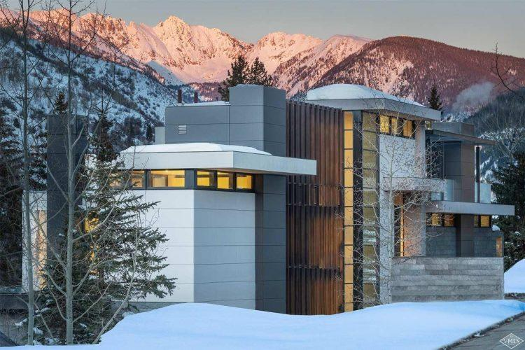 165 Forest Road on Vail Mountain: exterior with mountain sunset backdrop