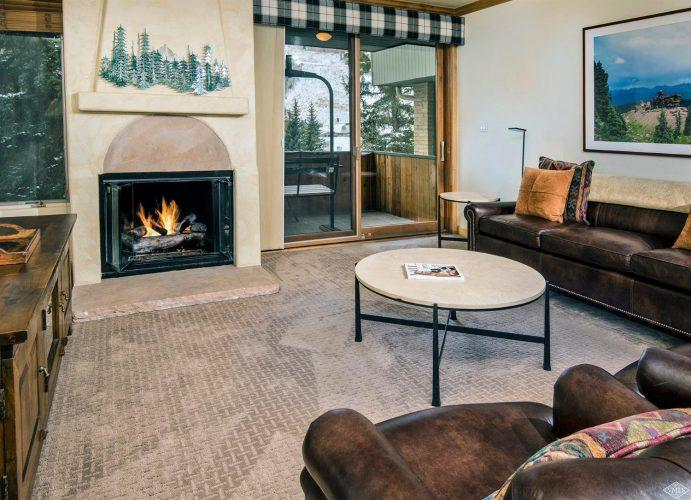 living area with fireplace at 292 Meadow Drive in the heart of Vail Village