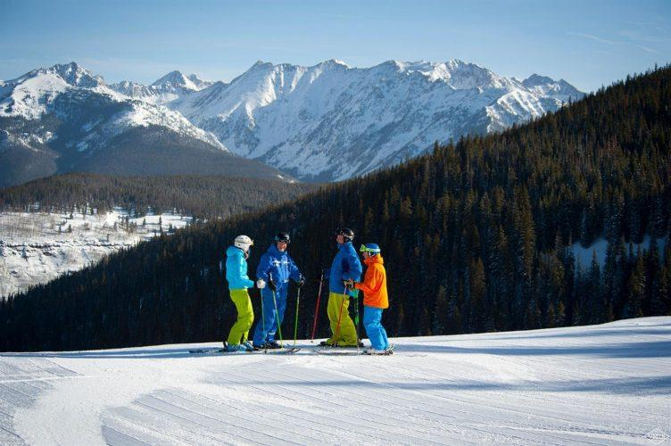 skiers at 292 Meadow Drive in the heart of Vail Village