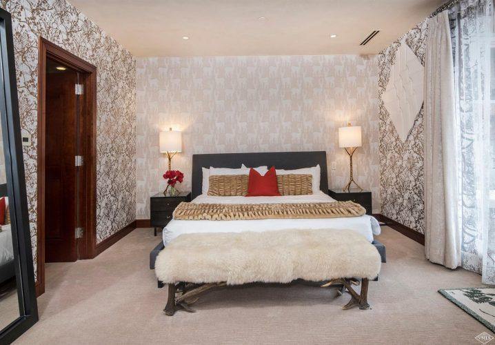 bedroom with busy wallpaper at 141 Meadow Drive in the south tower of Solaris
