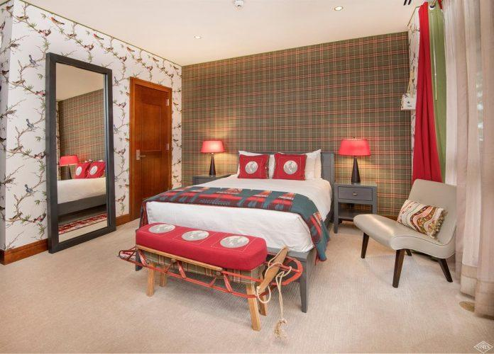 bedroom with tartan wallpaper at 141 Meadow Drive in the south tower of Solaris